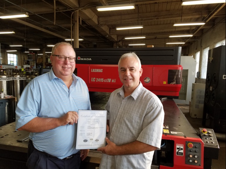 This Is A Photo Of Rick Miller, President Of AG Miller Co. Receiving The ISO 9001 Certification Of Quality